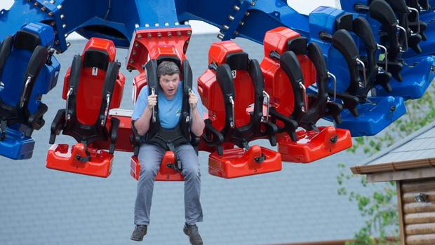Getting into the swing of things: Graham Clifford tries out the 'Rotator' at Tayto Park