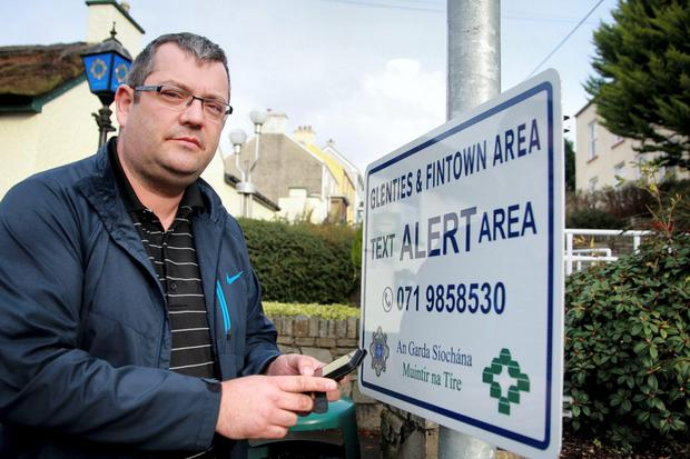 Brian Carr, chairman of the Glenties Action Group, at one of the text alert signs in Co Donegal. Photo: Brian McDaid