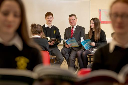 Liam O'Brien, Principal at Scoil Aireagail in Ballyhale Co. Kilkenny pictured with students Roy Cullen 6th year and Amy Laherty 3rd Year.