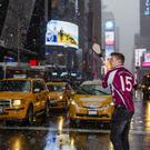 Drive it in: Galway hurler Joe Canning smashes a snowball in Midtown Manhattan
