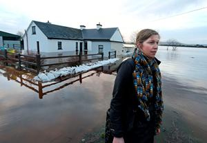 Anita Mundow at her mother Ann Connolly's flooded home at Ballinastague near Kinvara, Co Galway. Photo: Andrew Downes