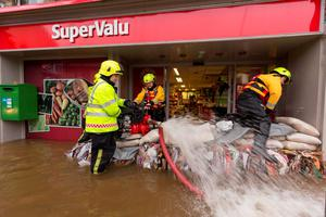 Firemen pump flood water out of SuperValu in Graiguenamanagh Co Kilkenny. Photo: Dylan Vaughan