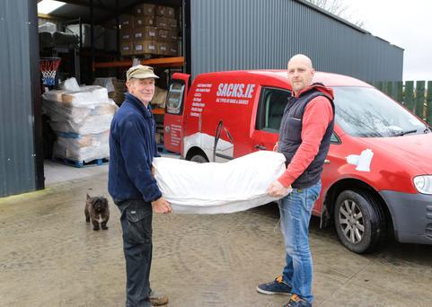 Martin Tierney and his father Dick of Sacks.ie load sandbags into their van in Annacotty, Co Limerick