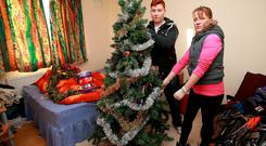 Christine Reynolds and her son Bailey dedcorate their Christmas tree in Christine's bedroom in Ballinasloe