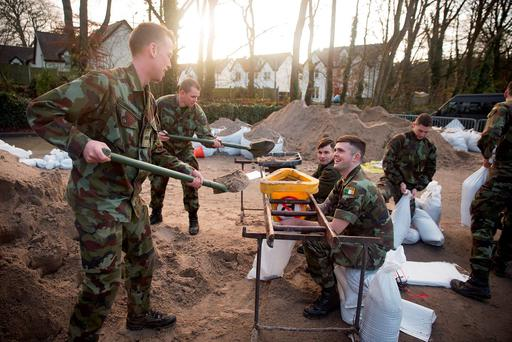 Members of the Irish Army placing sandbags around a house in Castleconnell