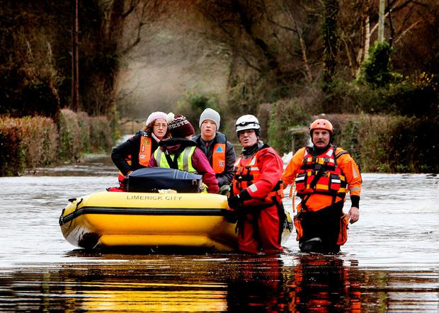 Liz Hogan with two of her children, Aoife and Mark, and the Civil Defence in East Clare