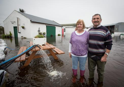 Mike and Gertie Dunning pump water at their farm in Athlone