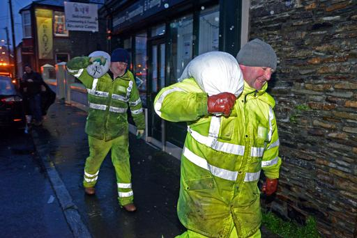 Council workers Teddy Leahy and Mick McCarthy deliver sandbags in Skibbereen, Co Cork
