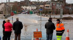 Flooding in Enniscorthy, Co Wexford after the River Slaney burst its banks and flowed over the bridge. Photo: Mary Browne