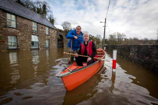 STRUGGLE: John Masterson pictured with Shem Caulfield in Thomastown in the same canoe that overturned while carrying Tanaiste Joan Burton. Photo: Dylan Vaughan