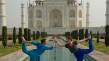 Emma and her backpacking friend Jennifer strike a yoga pose at the Taj Mahal