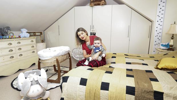 Sophie with baby Dominick in his room. He's wearing clothes from The Stork Box Grow range, with their adjustable sleeves and leggings