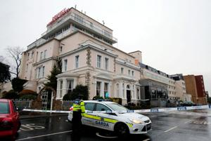 A garda cordon outside the Regency Hotel in Dublin after one man died and two others were injured following a shooting incident at the hotel on February 5 last year
