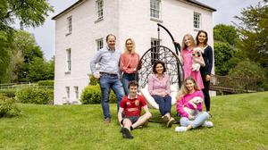 Claire and Gavin Dunne with their family at River Glebe House. Photo: Don Moloney