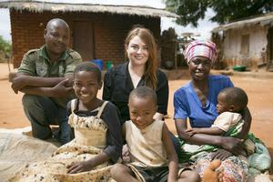 Samantha Barry with Mary James, Daudi Bernard and three of their children at their home in Luwalika village. Photo: Kieran McConville