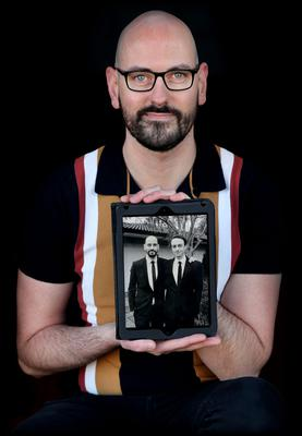 Chris Wasser holds a photograph of his twin brother Frank and himself. Photo: Steve Humphreys