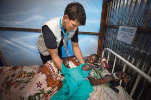 Donncha in the ante-natal ward with mother Nyathor Thuk (25) and her newborn girl, who was not yet named