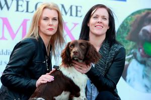 Peggy Mangan's daughters Louise Hollywood and Orla Lynch with Max at the handing over of search and rescue dog Max by the Peggy Mangan foundation to Dublin Civil Defence. Picture:Arthur Carron