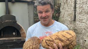 Rob Penn with a batch of home-made loaves