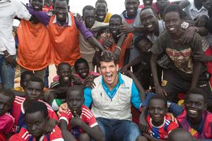 Donncha O'Callaghan with children in the Protection of Civilians (PoC) site 3, in Juba in South Sudan