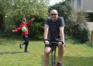 Mark is clocking up the miles on an exercise bike in the garden