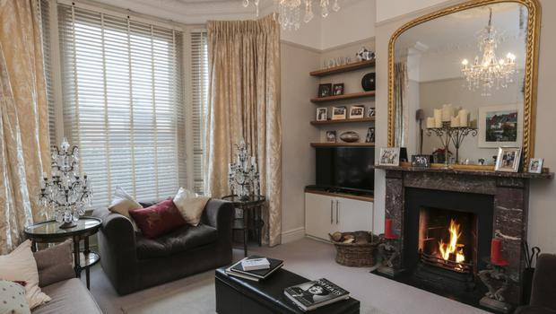 "The elegant living room, which has period features, is to the front of the house. It was decorated by Sophie's mum, and so has lovely antiques. ""It's more mum's style,"" says Sophie"