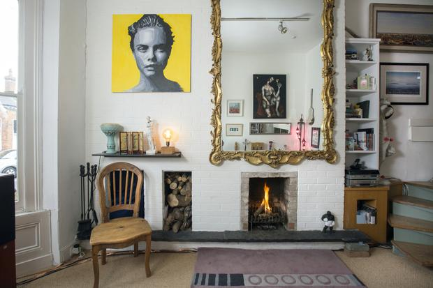 A detail of the double-height living room in award-winning songwriter/musician Eleanor McEvoy's welcoming home. The picture reflected in the mirror is by the late Chris Gollon, Eleanor's much-missed friend and collaborator