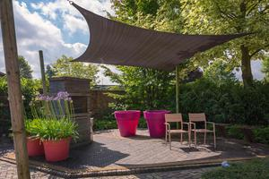 Use a retractable canopy or fabric sail to create a temporary canopy from spying eyes