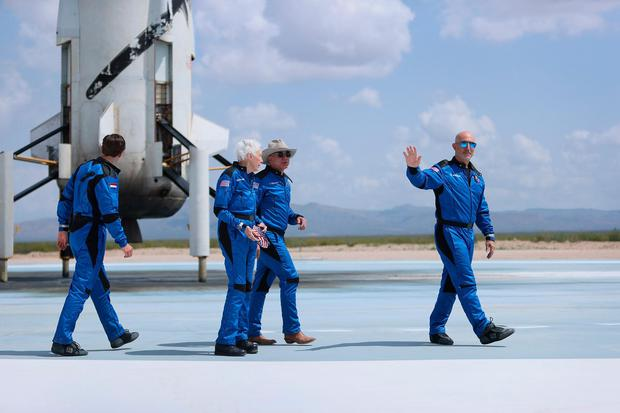 Amazon billionaire Jeff Bezos and his crew walk near his Blue Origin New Shepard space vehicle after flying into space in July this year. From left: Oliver Daemen, Wally Funk, Jeff Bezos and Mark Bezos. Photograph by: Joe Raedle