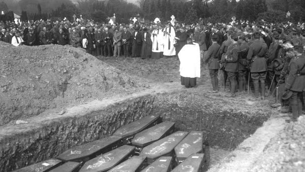 The majority were buried in three mass graves, with 80 remaining nameless. Playing on his mind as he marched was, perhaps, the question: 'Could I have done more to find out who they were' - a funeral service in Cobh held for some of the victims