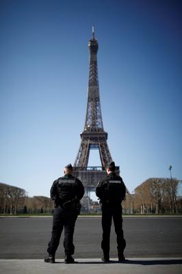 French Gendarmes patrol in front of the Eiffel tower in Paris. Photo: Benoit Tessier/Reuters