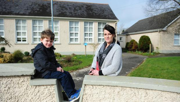 Dwindling numbers: Trish McDermott and her son Eamon (6), outside Ballacolla National School, which has lost two-thirds of its numbers. Photo: James Flynn/APX
