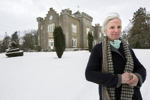 Artist Elizabeth Cope outside her home, Shankill Castle, in Paulstown, Co Kilkenny,  during the recent snow. She and her husband Geoffrey bought it in 1990