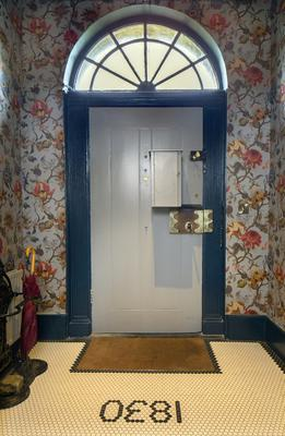 Sinead loves the fact that the house dates from 1830 and even had the date incorporated into the flooring. The front door, complete with its enormous brass lock, is also original; the original key, also huge, is kept in the letterbox on the door.