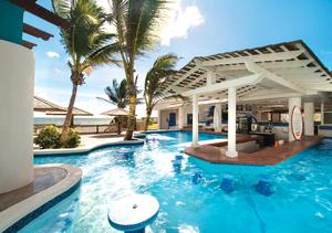 Just one of the pools and swim up bars the utterly sumptuous Coconut Bay Resort & Spa on the Caribbean island