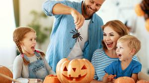 Family cut a pumpkin for holiday at home