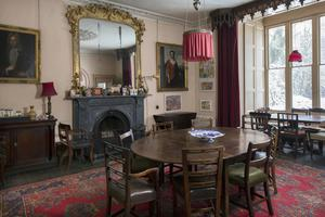 The dining room does have some period portraits, but they are not Geoffrey's and Elizabeth's ancestors; Geoffrey picked them  up at auction