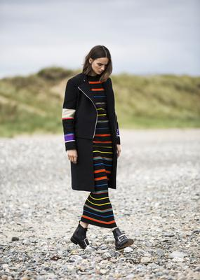 Coat, €3,900; knitted top, €1,099; knitted skirt, €1,105; boots, €1,095, all Givenchy