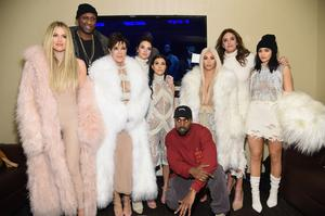 The Kardashian-Jenner family, from left to right, Khloe, Lemar Odom, Kris, Kendal, Kourtney, Kanye West, Kim, Caitlyn and Kylie.