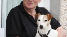 Shock: Michael Phylan (50) with his dog Rex. Michael was diagnosed with oesophageal cancer. Photo:  Liam Burke/Press 22