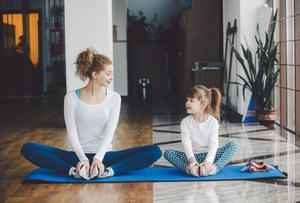 Create your own exercise routine at home and involve the children. Stock photo