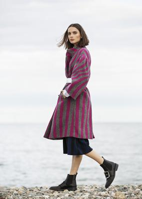Belted coat, €1,560; shirt (not in shot), €315; skirt, €620, all Dries Van Noten; boots, €1,095, Givenchy