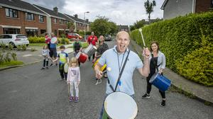 Drummer boy: Dave McFarlane leads neighbours and friends on his estate in Bray in a musical session. Photo: Mark Condren