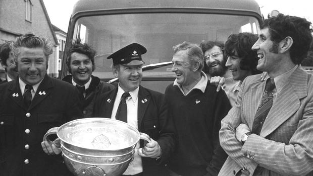 Heffo with the Sam Maguire and local firemen in Dublin in 1974