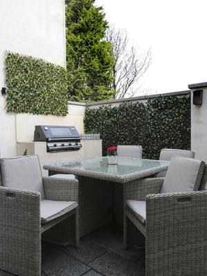 The kitchen extension took up a sizeable chunk of the garden, but they are very close to a lovely park, where they bring the kids. In any case, there is still room for a lovely patio with garden furniture and a barbecue