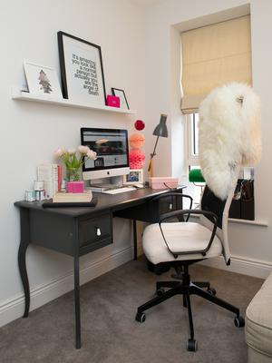 Caroline's office is prettily furnished, but a special orthopaedic chair is essential for her back