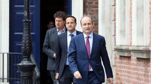 Leader of the Green Party Eamon Ryan with Tanaiste Leo Varadkar and Taoiseach Micheal Martin leaving the first Cabinet meeting in Dublin Castle in June. Photo by Sam Boal
