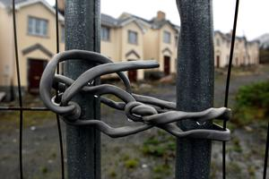 No entry: Electrical cable is used to secure a security fence surrounding Cnoc an Iuir, an empty and unsold housing development in the village of Drumshanbo, Co Leitrim