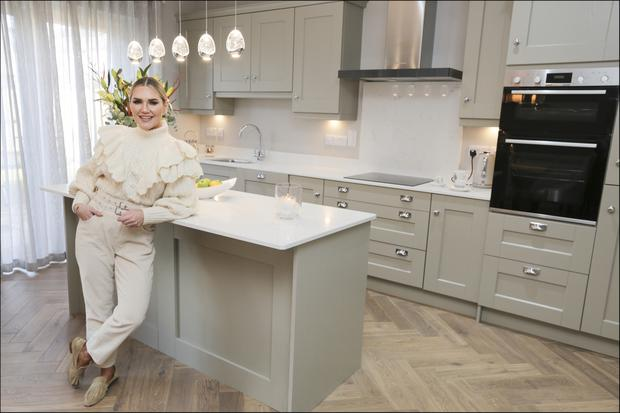 Performer and influencer Erin McGregor in her new kitchen with its quartz worktops. Her partner, Terry, does all the cooking at the moment, but she may take lessons in the new year. Photo: David Conachy