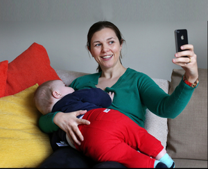 Chrissie Russell breastfeeds her son Tom